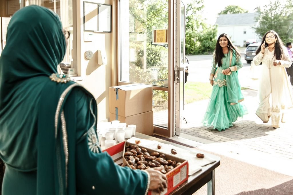Welcomed with dates at his astoundingly beautiful rehearsal dinner - wedding photography - Indian wedding photography